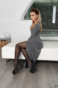 Gorgeous Blonde Katrin Tequila Strips And Poses In Stockings - 00