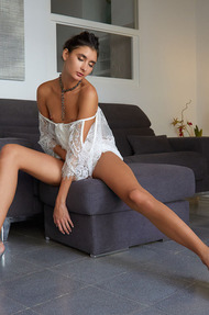 Gorgeous Bambi Joli perches on the edge of her chair - 02
