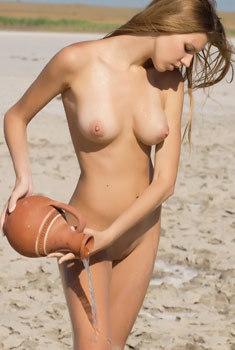 Sexy Iveta Gets Wet On The Beach