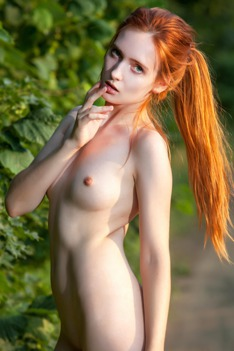 Redhead May In The Nature