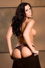 Rachel Starr shows off her hot DDs and fine bottom in this quickie striptease photo shoot