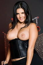 Sunny Leone unzips her sexy plaid bra corset and poses naked