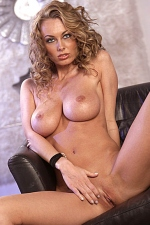 Anita Dark takes off her polka-dot top and black undies to enjoy playing with her perfect naked breasts and pussy