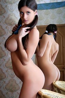 Hot Cutie Posing By The Mirror
